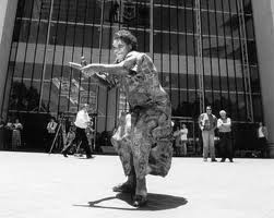 Gladys Tybingoompa dances outside the High Court.